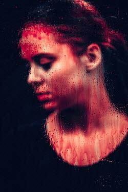 Magdalena Russocka woman behind bloody window
