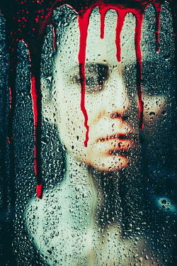 Magdalena Russocka woman behind bloody window