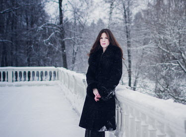 Irina Orwald BRUNETTE GIRL ON GRAND VERANDA IN SNOW Women