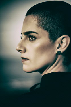 Mohamad Itani CLOSE UP OF WOMAN WITH SHAVEN HEAD IN PROFILE Women