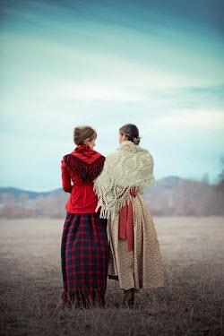 Ildiko Neer Two historical women standing in field Women