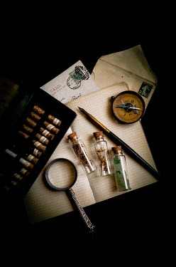 Jane Morley BOTANY SAMPLES COMPASS AND MAGNIFYING GLASS ON NOTEPAD Miscellaneous Objects
