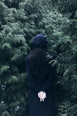 Alina Zhidovinova WOMAN IN HAT BY TREE IN WINTER Women