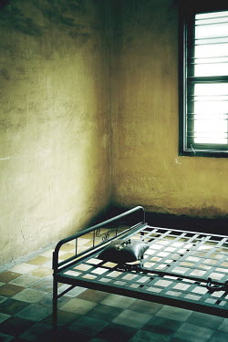Irene Lamprakou EMPTY METAL BED IN SHABBY ROOM Interiors/Rooms