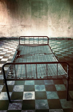 Irene Lamprakou METAL BED IN DIRTY SHABBY ROOM Interiors/Rooms