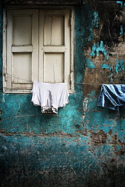 Irene Lamprakou CLOTHES ON WASHING LINE OUTSIDE WEATHERED HOUSE Building Detail