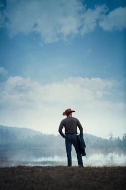 Magdalena Russocka cowboy standing at lake