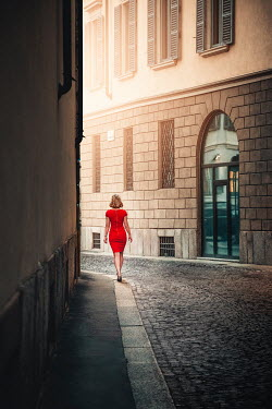 Evelina Kremsdorf Woman in red dress walking on street in Milan, Italy