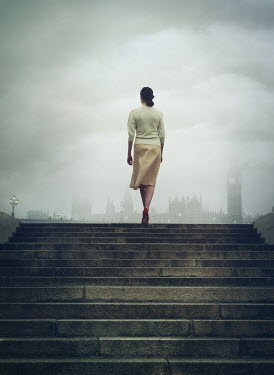 Mark Owen Young woman walking up steps in London