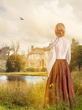 Victoria Davies Victorian woman standing in garden under sunshine