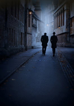 Lyn Randle TWO MEN WALKING IN OLD CITY STREET AT NIGHT Men