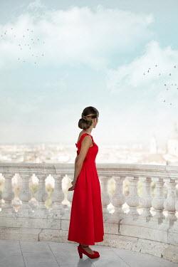 Ildiko Neer Woman in evening gown standing on balcony