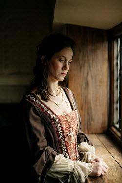 Shelley Richmond Woman in medieval dress by window