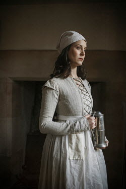 Shelley Richmond Woman in medieval maid dress and hat holding pitcher
