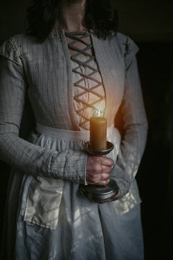 Shelley Richmond Woman in medieval dress holding candle