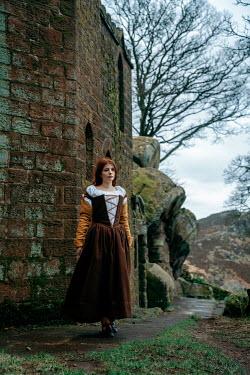 Rekha Garton Young woman in medieval dress by castle ruin