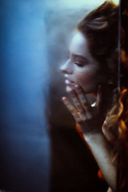 Marta Syrko Reflection of young woman in mirror