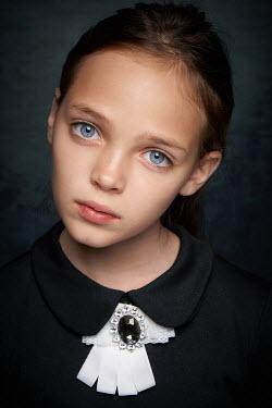 Alexander Vinogradov CLOSE UP OF SAD LITTLE GIRL WITH BLUE EYES Children