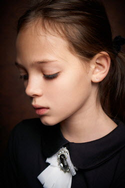 Alexander Vinogradov CLOSE UP OF SAD LITTLE GIRL WITH BROOCH Children