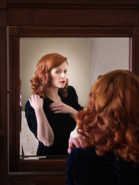 Elisabeth Ansley WOMAN WITH RED HAIR REFLECTED IN MIRROR Women