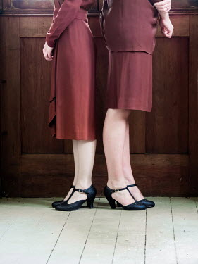 Elisabeth Ansley TWO RETRO WOMEN STANDING BACK TO BACK Women