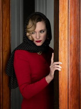 Elisabeth Ansley BLONDE WOMAN IN HEAD SCARF OPENING DOOR Women