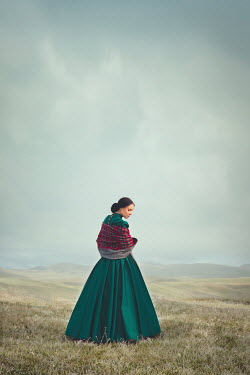 Joanna Czogala HISTORICAL WOMAN WEARING PLAID SHAWL IN COUNTRYSIDE Women