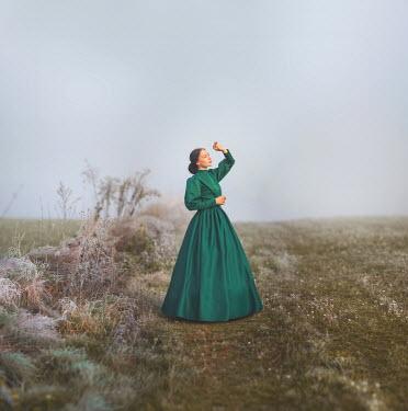 Joanna Czogala HISTORICAL WOMAN SHIELDING EYES IN COUNTRYSIDE Women