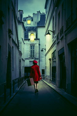 Marie Carr WOMAN CARRYING SUITCASE AT NIGHT IN CITY Women