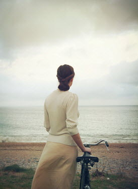 Mark Owen WOMAN WITH BICYCLE WATCHING OCEAN Women