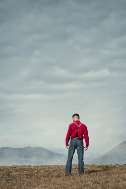 Magdalena Russocka man standing in field with mountains