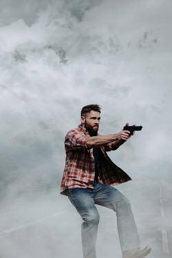Magdalena Russocka modern man aiming gun