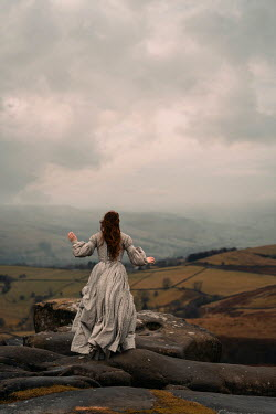 Rekha Garton HISTORICAL WOMAN ON ROCKS IN WINTRY COUNTRYSIDE Women