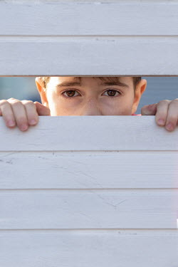 Galya Ivanova LITTLE BOY PEERING THROUGH WHITE FENCE Children