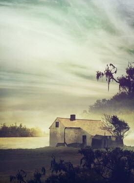 Mark Owen WEATHERED HOUSE BY LAKE AT DUSK Houses
