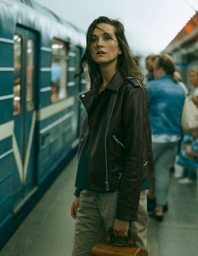 Maria Yakimova WOMAN ON TRAIN PLATFORM WITH CROWD Women