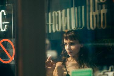 Maria Yakimova STARING WOMAN BY WINDOW IN CAFE Women