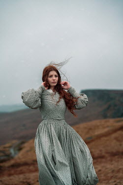 Rekha Garton WOMAN WITH RED HAIR IN WINDY COUNTRYSIDE Women