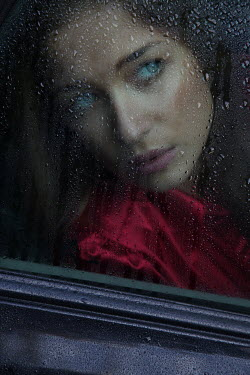 Allan Jenkins WOMAN WATCHING BEHIND WET CAR WINDOW Women