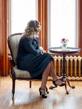 Elisabeth Ansley BLONDE RETRO WOMAN SITTING BY WINDOW Women