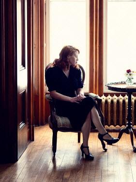 Elisabeth Ansley SAD RETRO WOMAN SITTING BY WINDOW Women