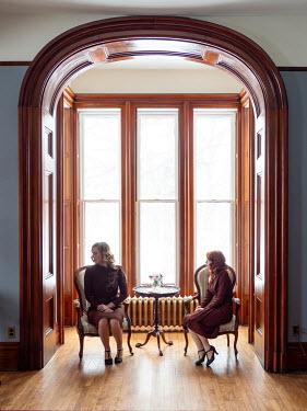 Elisabeth Ansley TWO RETRO WOMEN SITTING BY WINDOW Women