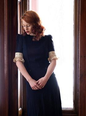 Elisabeth Ansley SAD RETRO WOMAN WITH RED HAIR BY WINDOW Women