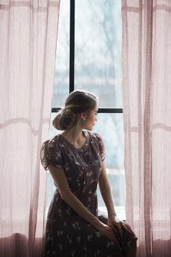 Ildiko Neer Vintage woman sitting on window sill