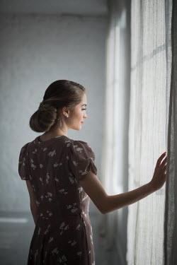 Ildiko Neer Vintage woman standing by window