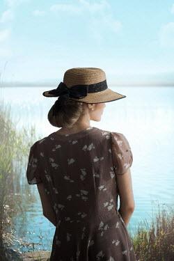 Ildiko Neer Vintage woman standing by lake