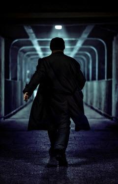 Jaroslaw Blaminsky MAN WALKING IN TUNNEL AT NIGHT Men