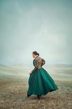 Joanna Czogala BRUNETTE TUDOR WOMAN WALKING IN COUNTRYSIDE Women