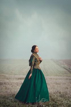 Joanna Czogala BRUNETTE TUDOR WOMAN STANDING IN COUNTRYSIDE Women