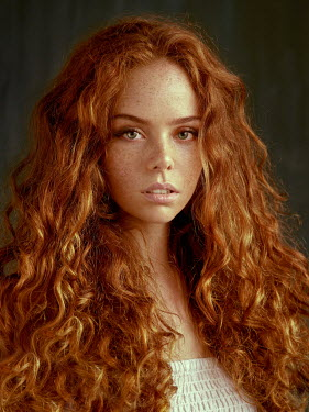 Alexander Vinogradov CLOSE UP OF GIRL WITH LONG CURLY RED HAIR Women